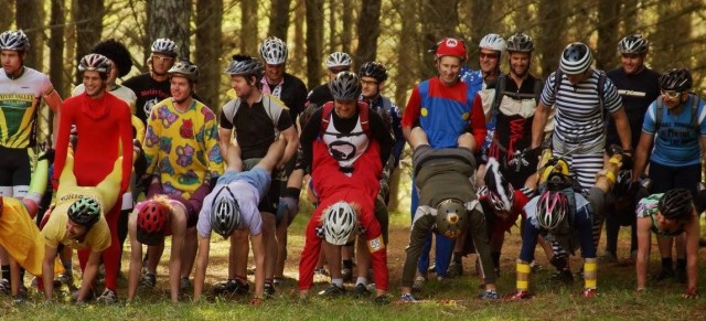 Riders lined up for a wheelbarrow race at the start of Single Speed Sundays 2013